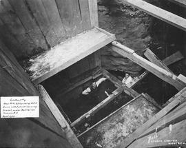 Manhole at Notre-Dame & St. John showing trench under Bell Telephone Co / Rice Studio Limited...